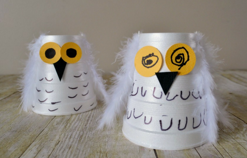Transform basic styrofoam cups into adorable snowy owls with the help of some feathers.