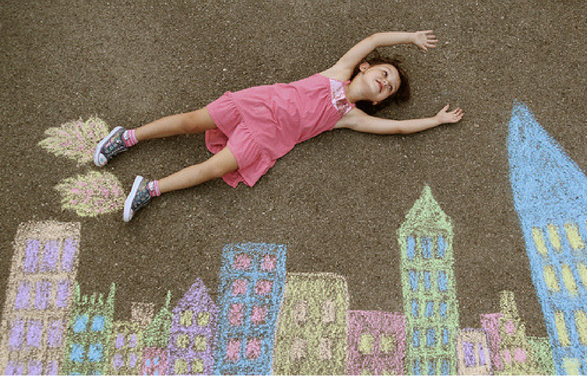 Transform your kid into a superhero with the help of a simple chalk skyline.