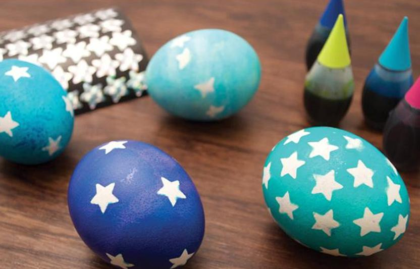 Kids love to put stickers on paper, cards, and notebooks. So why not put them on Easter eggs?